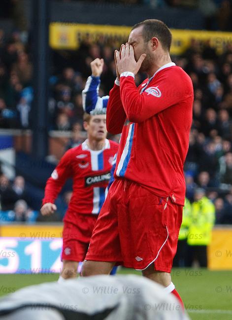 Kris Boyd hangs his head after seeing his penalty kick saved