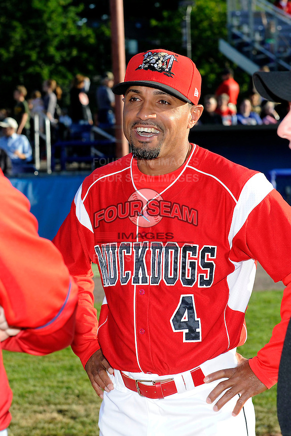 Batavia Muckdogs manager Angel Espada #4 during the lineup exchange before a game against the Auburn Doubledays on June 18, 2013 at Dwyer Stadium in Batavia, New York.  Batavia defeated Auburn 10-2.  (Mike Janes/Four Seam Images)
