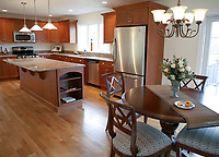 "Kathleen Farrell, owner of home staging company, ""Staged Effect"", staged this kitchen in a home built by R.W. Anderson and Sons Inc. in Sandwich, Ma.  Farrell furnishes and decorates the homes she stages to aid in the sale of the home.  12/12/06 Julia Cumes"