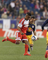 Foxborough, Massachusetts - May 2, 2015: In a Major League Soccer (MLS) match, the New England Revolution (red) defeated New York Red Bulls (blue/yellow), 2-1, at Gillette Stadium.