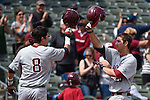 May 21, 2015; Stockton, CA, USA; Loyola Marymount Lions infielder David Edwards (28, right) is congratulated by outfielder Austin Miller (8) for hitting a grand slam during the WCC Baseball Championship against the San Diego Toreros at Banner Island Ballpark.