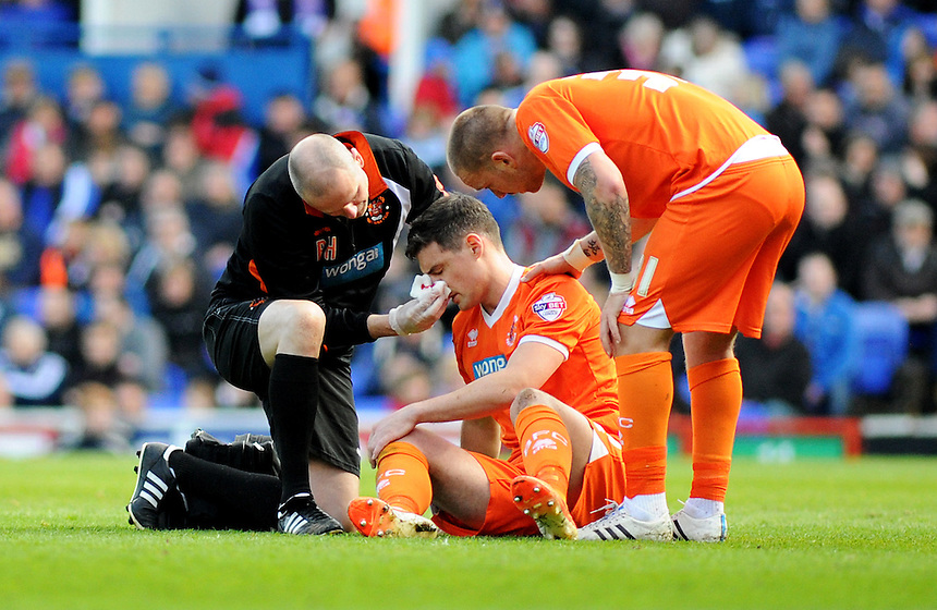 Blackpool's Darren O'Dea is treated for a nosebleed as team-mate Jamie O'Hara shows concern <br /> <br /> Photographer Kevin Barnes/CameraSport<br /> <br /> Football - The Football League Sky Bet Championship - Ipswich Town v  Blackpool - Saturday 11th April 2015 - Portman Road - Ipswich<br /> <br /> &copy; CameraSport - 43 Linden Ave. Countesthorpe. Leicester. England. LE8 5PG - Tel: +44 (0) 116 277 4147 - admin@camerasport.com - www.camerasport.com