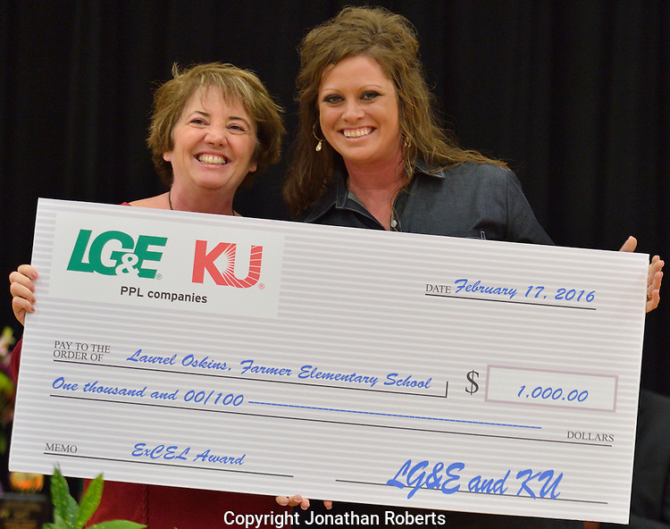 Laurel Oskins, a fifth-grade teacher at Farmer Elementary, receives the Excellence in Classroom and Educational Leadership (ExCEL) Award, sponsored by LG&E and KU Energy and WHAS-TV.