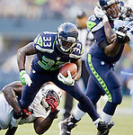 Seattle Seahawks' running back Leon Washington runs through an attempted tackle by the Tennessee Titans linebacker Tim Shaw in a pre-season game at CenturyLink Field in Seattle, Washington on August 11, 2012. ©2012. Jim Bryant Photo. All Rights Reserved..