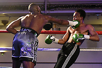 Derrick Osaze (silver shorts) defeats Victor Edagha during a Boxing Show at the Camden Centre on 10th March 2018