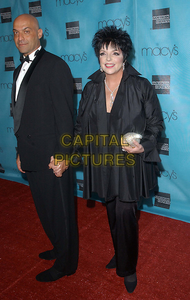 LIZA MINNELLI & ESCORT.Macy's & American Express Passport Gala to raise funds for HIV/AIDS held at Santa Monica's Barker Hangar.full length, full-length.www.capitalpictures.com.sales@capitalpictures.com.©Capital Pictures.