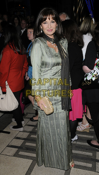 STEPHANIE BEACHAM.At the Apollo Victoria's special performance to celebrate the venue's 80th birthday, Apollo Victoria theatre, London, England, UK, .October 10th 2010..full length silver green scarf shiny long maxi dress gold clutch bag sleeve striped grey gray .CAP/CAN.©Can Nguyen/Capital Pictures.