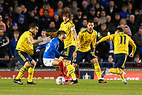 Marcus Harness of Portsmouth is surrounded by Arsenal players during Portsmouth vs Arsenal, Emirates FA Cup Football at Fratton Park on 2nd March 2020