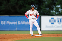 Second baseman Yoan Moncada (24) of the Greenville Drive stands on second base in a game against the Lexington Legends on Monday, May 18, 2015, at Fluor Field at the West End in Greenville, South Carolina. Moncada, a 19-year-old prospect from Cuba, made his professional debut tonight in the Red Sox organization. (Tom Priddy/Four Seam Images)