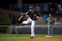 Salem-Keizer Volcanoes relief pitcher Francis Pena (39) follows through on his delivery during a Northwest League game against the Eugene Emeralds at Volcanoes Stadium on August 31, 2018 in Keizer, Oregon. The Eugene Emeralds defeated the Salem-Keizer Volcanoes by a score of 7-3. (Zachary Lucy/Four Seam Images)