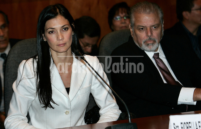 Fiorella Fare, left, wife of FIFA agent Carlos Delgado, speaks during a session at Peruvian Congress in Lima, Peru, Monday, March 23, 2009. Fare denounces her husband for fraud to differents soccer players. Peruvian striker Claudio Pizarro, who is on loan to Werder Bremen from Chelsea, also has been implicated in the fraud investigation targeting his agent Carlos Delgado. Pizarro allegedly has a stake in Delgado's company Image. At right is Edgardo Mercado, Fiorella Fare's lawyer. Archivolatino/Karel Navarro