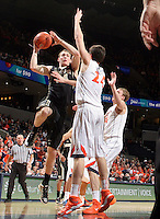 Wake Forest forward Tyler Cavanaugh (34) shoots over Virginia forward Caid Kirven (24) during the game Wednesday Jan. 08, 2014 in Charlottesville, Va. Virginia defeated Wake Forest 74-51.