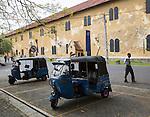 Motor rickshaw known as tuk-tuks inside the fort area of historic town of Galle, Sri Lanka, Asia