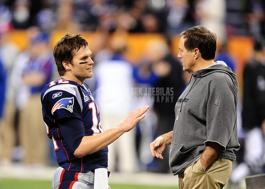 Feb 5, 2012; Indianapolis, IN, USA; New England Patriots quarterback Tom Brady (12) shakes hands with head coach Bill Belichick before Super Bowl XLVI against the New York Giants at Lucas Oil Stadium.  Mandatory Credit: Mark J. Rebilas-