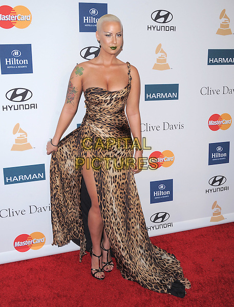 Amber Rose.attends the Annual Clive Davis & The Recording Company Pre-Grammy Gala held at The Beverly Hilton in Beverly Hills, California, USA, .February 11th 2011..grammys party full length leopard print one shoulder strap dress long maxi  animal  slit split train tattoo beauty make-up green lips lipstick eyelashes false lashes  shaved head hair bleached earrings     flashing thigh .CAP/RKE/DVS.©DVS/RockinExposures/Capital Pictures.
