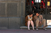 Street performers dressed as early 20th-century immigrants rest on the Plaza Dorrego in Buenos Aires. Noted Argentine author Jorge Luis Borges wrote often about people on the margins -- thugs, knife fighters, prostitutes and scoundrels. The magic realist author influenced the work of many of the western hemisphere's greatest writers.<br /><br />(Kevin Moloney for the New York Times)