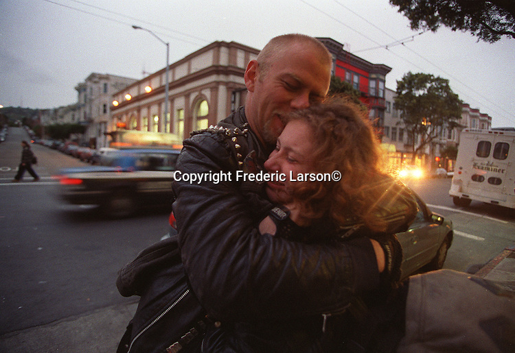 Travis greets his girlfriend Shera on Haight Street after returning from jail in San Francisco, California.