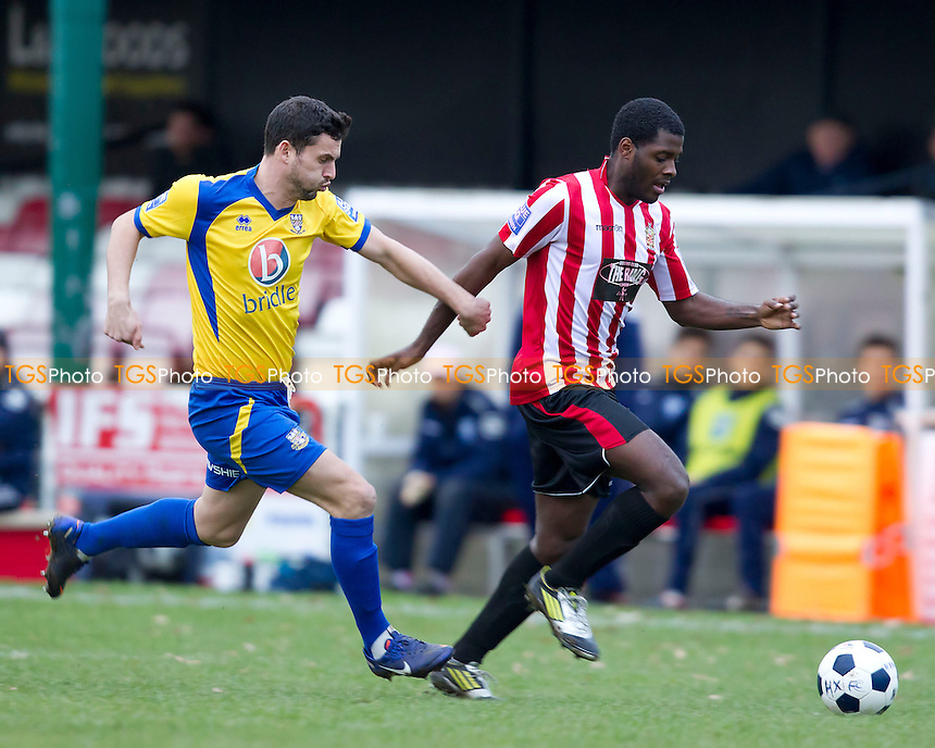 Rimmel Daniel of AFC Hornchurch tries to get past the attentions of Jamie Hand of Eastleigh - AFC Hornchurch vs Eastleigh - Blue Square Conference South Football at The Stadium, Upminster, Essex - 17/11/12 - MANDATORY CREDIT: Ray Lawrence/TGSPHOTO - Self billing applies where appropriate - 0845 094 6026 - contact@tgsphoto.co.uk - NO UNPAID USE.