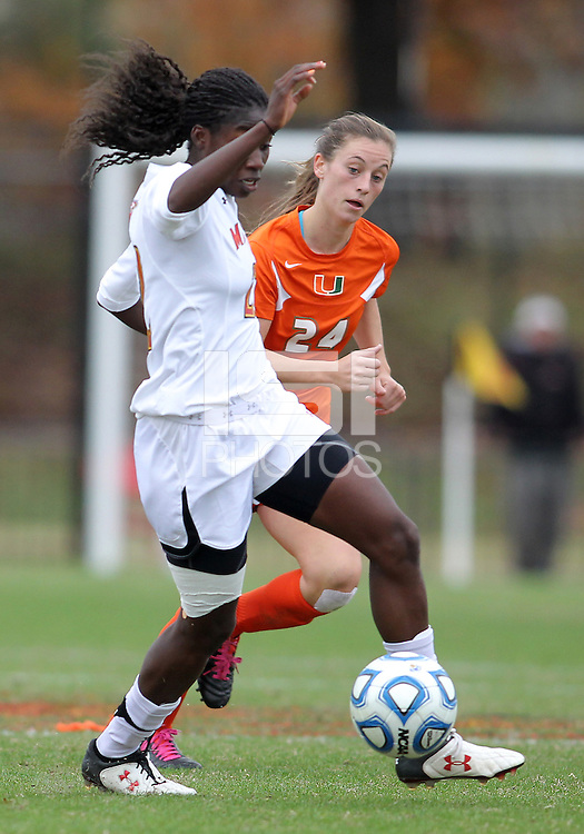 COLLEGE PARK, MD - OCTOBER 28, 2012:  Shade Pratt (22) of the University of Maryland moves the ball away from Tara Schwitter (24) of Miami during an ACC  women's tournament 1st. round match at Ludwig Field in College Park, MD. on October 28. Maryland won 2-1 on a golden goal in extra time.