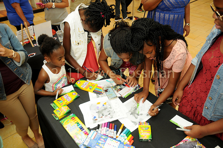 Kids enter to win prizes at the M.D. Anderson Back to School Fashion show at the Galleria Saturday Aug. 06,2016.(Dave Rossman Photo)