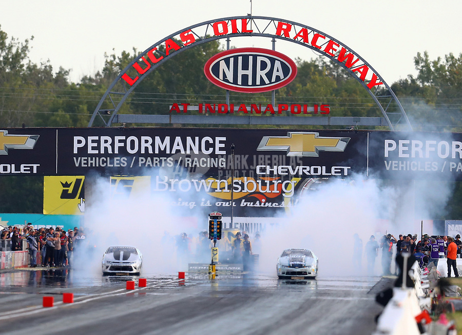 Sep 2, 2017; Clermont, IN, USA; NHRA pro stock driver Chris McGaha (left) does a burnout alongside Matt Hartford during qualifying for the US Nationals at Lucas Oil Raceway. Mandatory Credit: Mark J. Rebilas-USA TODAY Sports