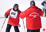 NEW HARTFORD, CT- 28 February 2009 --022809JS06-Earl Eccmes of the Southbury Training School ski team is greeted by coach Steve Paul after finishing his run during the giant slalom alpine event during the Special Olympics Connecticut's 2009 Winter Games at Ski Sundown in New Hartford on Saturday. Ski Sundown was just one of four venues throughout the state for the winter games this weekend. Compeition continues today (Sunday) starting at 9 a.m.<br /> Jim Shannon Republican-American