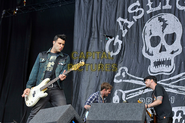 Alex Levine of The Gaslight Anthem.performing on Day 3 at Reading Festival, Reading, England. .26th August 2012.on stage in concert live gig performance performing music half length black top jean denim jacket bass guitar .CAP/MAR.© Martin Harris/Capital Pictures.
