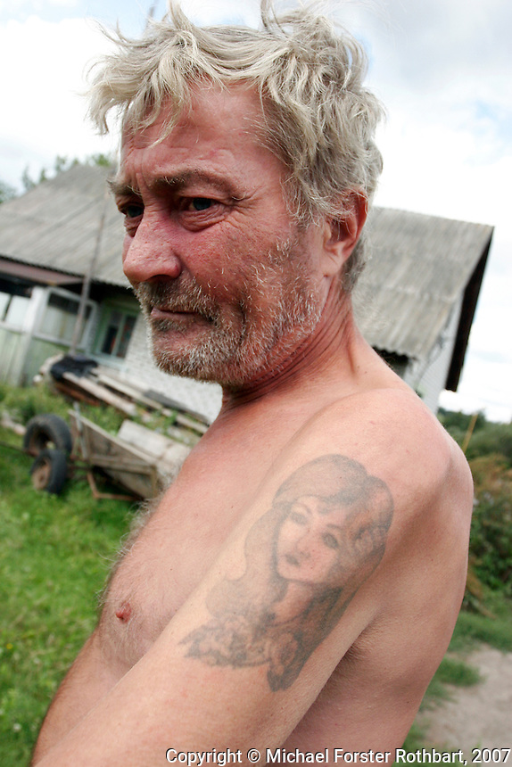 &ldquo;I was born here and I'll die here. I already want to die. Forgive me, I'm drunk. I drink a lot now. We only have what God gives us, our health, our place, our friends.&rdquo; <br /> &mdash; Vasily Kozachenko, farmer<br /> <br /> After his wife, Natasha, died in January 2007, Vasily Kozachenko tattooed her face on his shoulder. She died from liver cancer after a long illness, a few days after her 46th birthday. He then lived alone, farming a small plot of land on the outskirts of Ivankiv, the closest inhabited city to Chernobyl. Vasily died of stomach cancer as I was finishing this book. He was 57.<br /> ------------------- <br /> This photograph is part the book of Would You Stay?, by Michael Forster Rothbart, published by TED Books in 2013. The photos come from Forster Rothbart&rsquo;s two long-term documentary photography projects, After Chernobyl and After Fukushima.<br /> &copy; Michael Forster Rothbart 2007-2013.<br /> www.afterchernobyl.com<br /> www.mfrphoto.com &bull; 607-267-4893 &bull; 607-436-2856 <br /> 34 Spruce St, Oneonta, NY 13820<br /> 86 Three Mile Pond Rd, Vassalboro, ME 04989<br /> info@mfrphoto.com<br /> Photo by: Michael Forster Rothbart<br /> Date:  8/2007    File#:  Canon 20D digital camera frame 14285 <br /> -------------------