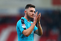 Lewis Coyle of Fleetwood Town applauds the traveling Fleetwood Town fans after the Sky Bet League 1 match between Doncaster Rovers and Fleetwood Town at the Keepmoat Stadium, Doncaster, England on 17 February 2018. Photo by Leila Coker / PRiME Media Images.