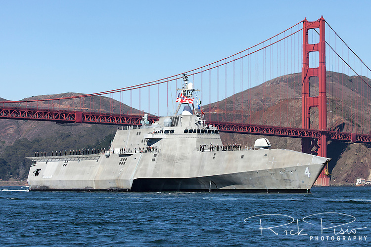 The Independence-class littoral combat ship USS Coronado (LCS-4) passes under the Golden Gate Bridge as it enters San Francisco Bay. The Independance class is an aluminum trimaran hull that is designed to provide access in coastal waters for missions such as mine warfare, anti-submarine warfare and surface warfare.