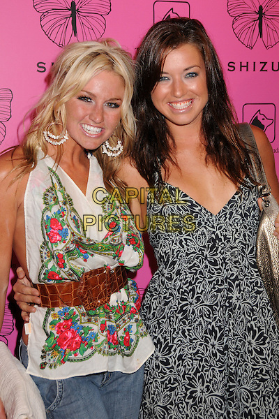 LAUREN BERGFELD & PARVATI SHALLOW .Shizue Boutique Grand Opening Soiree at Shizue Boutique, Beverly Hills, California, USA..June 26th, 2008.half length black white pattern dress top brown belt red green floral print .CAP/ADM/BP.©Byron Purvis/AdMedia/Capital Pictures.