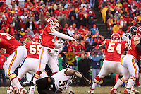 Chiefs quarterback Trent Green throws a pass from the pocket with Jacksonville Jaguars linebacker Daryl Smith at his feet during the first half at Arrowhead Stadium in Kansas City, Missouri on December 31, 2006. The Chiefs won 35-30.