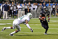 20 December 2011:  FIU wide receiver T.Y. Hilton (4) attempts to evade Marshall safety Omar Brown (31) after a reception in the first quarter as the Marshall University Thundering Herd defeated the FIU Golden Panthers, 20-10, to win the Beef 'O'Brady's St. Petersburg Bowl at Tropicana Field in St. Petersburg, Florida.