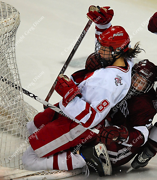 """6'1"""" Badger junior Jinelle Zaugg cannot be brought down for long, a minute later scoring the winning goal in the 4th overtime at the Kohl Center against Harvard Saturday night"""