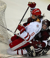 "6'1"" Badger junior Jinelle Zaugg cannot be brought down for long, a minute later scoring the winning goal in the 4th overtime at the Kohl Center against Harvard Saturday night"