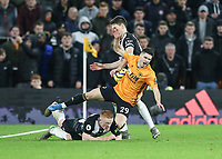 Newcastle United's Matthew Longstaff fouls Wolverhampton Wanderers' Ruben Vinagre and was booked with Newcastle United's Federico Fernandez close by<br /> <br /> Photographer Lee Parker/CameraSport<br /> <br /> The Premier League - Wolverhampton Wanderers v Newcastle United - Saturday 11th January 2020 - Molineux - Wolverhampton<br /> <br /> World Copyright © 2020 CameraSport. All rights reserved. 43 Linden Ave. Countesthorpe. Leicester. England. LE8 5PG - Tel: +44 (0) 116 277 4147 - admin@camerasport.com - www.camerasport.com