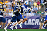 FOXBORO, MA - MAY 28: John Bassett (4) of the Merrimack Warriors races past Jordan Stouros (7) of the LImestone Saints during the Division II Men's Lacrosse Championship held at Gillette Stadium on May 28, 2017 in Foxboro, Massachusetts. (Photo by Larry French/NCAA Photos via Getty Images)