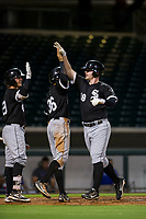 AZL White Sox left fielder Alex Destino (18) celebrates with teammates Michael Hickman (29) and Laz Rivero (36) after hitting a home run against the AZL Cubs on August 13, 2017 at Sloan Park in Mesa, Arizona. AZL White Sox defeated the AZL Cubs 7-4. (Zachary Lucy/Four Seam Images)