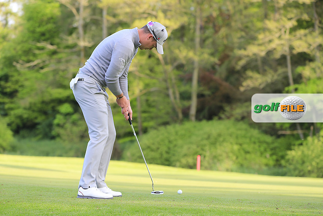 Danny Willett (ENG) takes his putt on the 17th green during Thursday's Round 1 of the 2016 Dubai Duty Free Irish Open hosted by Rory Foundation held at the K Club, Straffan, Co.Kildare, Ireland. 19th May 2016.<br /> Picture: Eoin Clarke | Golffile<br /> <br /> <br /> All photos usage must carry mandatory copyright credit (&copy; Golffile | Eoin Clarke)