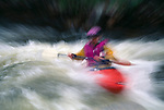 Kayaker paddling in spring runoff (abstract), Rocky Mtns, CO