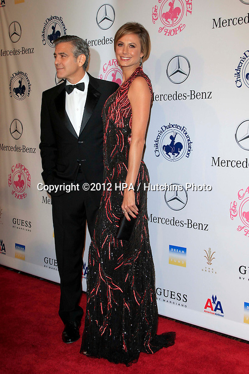 LOS ANGELES - OCT 20:  George Clooney, Stacy Keibler arrives at  the 26th Carousel Of Hope Ball at Beverly Hilton Hotel on October 20, 2012 in Beverly Hills, CA