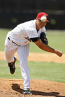 July 11, 2009:  Pitcher Michael Schurz (12) of the GCL Astros delivers a pitch during a game at Osceola County Complex in Kissimmee, FL.  The GCL Astros are the Gulf Coast Rookie League affiliate of the Houston Astros.  Photo By Mike Janes/Four Seam Images