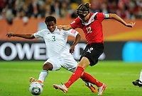 Christine Sinclair (r) of team Canada and Osinachi Ohale of team Nigeria during the FIFA Women's World Cup at the FIFA Stadium in Dresden, Germany on July 5th, 2011.