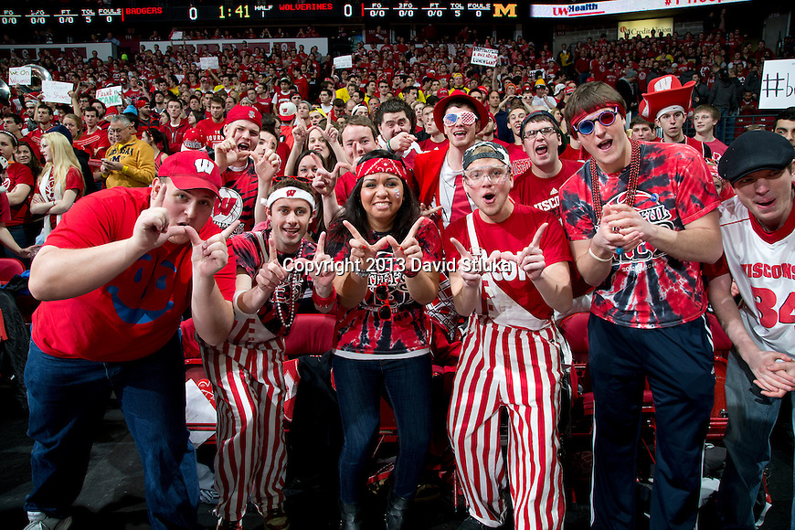 Wisconsin Badger fans pose cheer during a Big Ten Conference NCAA college basketball game against the Michigan Wolverines Saturday, February 9, 2013, in Madison, Wis. The Badgers won 65-62 (OT). (Photo by David Stluka)