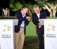 CALI -COLOMBIA-23-05-2013. Juan Manuel Santos  Presidente de Colombia, y Sebastian Piñera presidente de Chile durante el acto de clausura de la VII Cumbre de la Alianza del Pacífico, en la ciudad de Cali, en el departamento del Valle del Cauca, Colombia, mayo 23 de 2013. La Alianza del Pacífico es un mecanismo de integración creado formalmente en 2012 para propiciar el libre flujo de bienes, inversiones y personas entre sus socios, Colombia, México, Chile y Perú para la búsqueda conjunta de mercados, especialmente en la zona Asia-Pacífico. (Foto: VizzorImage / Juan C Quintero / Str). Juan Manuel Santos, President of Colombia, and Sebastiaqn Piñera, president of Chile, during closing ceremony of the VII Summit of the Pacific Alliance, in Cali, department of Valle del Cauca, Colombia, May 23, 2013. Pacific Alliance is an integration mechanism formally established in 2012 to promote the free flow of goods, investments and people between its partners, Colombia, Mexico, Chile and Peru to the joint search for markets, especially in Asia-Pacific..  Photo: VizzorImage/Juan C. Quintero/STR