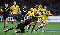 Kurtley Beale of the Wallabies is tackled by Richie Mo'unga of the All Blacks during the Rugby Championship match between Australia and New Zealand at Optus Stadium in Perth, Australia on August 10, 2019 . Photo: Gary Day / Frozen In Motion