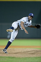Wilmington Blue Rocks relief pitcher Robinson Yambati (15) follows through on his delivery against the Winston-Salem Dash at BB&T Ballpark on July 30, 2015 in Winston-Salem, North Carolina.  The Dash defeated the Blue Rocks 7-3.  (Brian Westerholt/Four Seam Images)