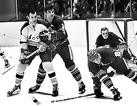 Seals vs Buffalo Sabres 1971..Seals Gerry Ehman held by #3 Tracy Pratt, Jean-Guy Talbot and goalie Roger Crozier...(photo/Ron Riesterer).