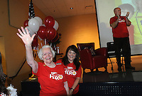 """NWA Democrat-Gazette/FLIP PUTTHOFF <br /> MARY MAE HERO<br /> Mary Mae Jones, 91, is introduced Friday Sept. 25 2015 by Principal Ashley Williams to students and faculty at Mary Mae Jones Elementary in Bentonville during an assembly honoring Jones as the winner of the """"Share Your Hero"""" contest sponsored by Mrs. Fields brand cookies of Broomfield, Colo. The contest drew nominations from around the world, a company representative said at the assembly.  Jamie Gaston, school nurse, nominated Jones for the award. Jones was chosen for her years of dedication to teaching and inspiring thousands of students.  Jones began teaching in Dumas in 1943 at age 19. She moved to Bentonville in 1962 and did not fully retire from teaching until 2005. Students at the assembly received cupcakes distributed by employees of Mrs. Fields brands. At right is Mike Poore, superintendent of the Bentonville district."""