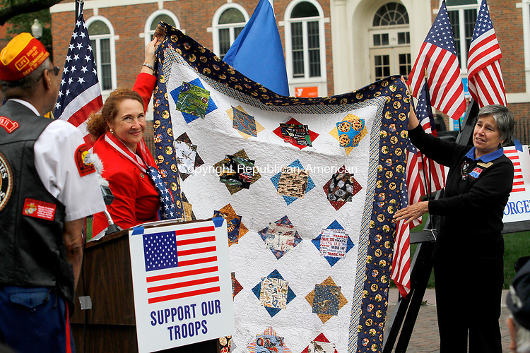 WATERBURY, CT - 29 JULY 2017 - 072917JW04.jpg -- Rep. Elizabeth H. Esty, D-5th District and Quilts of Valor Foundation Co-coordinator Jane Dougherty present Samuel K. Beamon with a quilt honoring his service as a birthday present during the Korean War Remembrance Day Ceremony Saturday morning on the Waterbury Green.  Jonathan Wilcox Republican-American